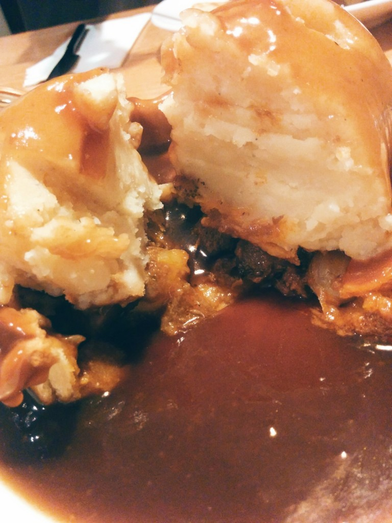 There is a pie there, between the mash and gravy
